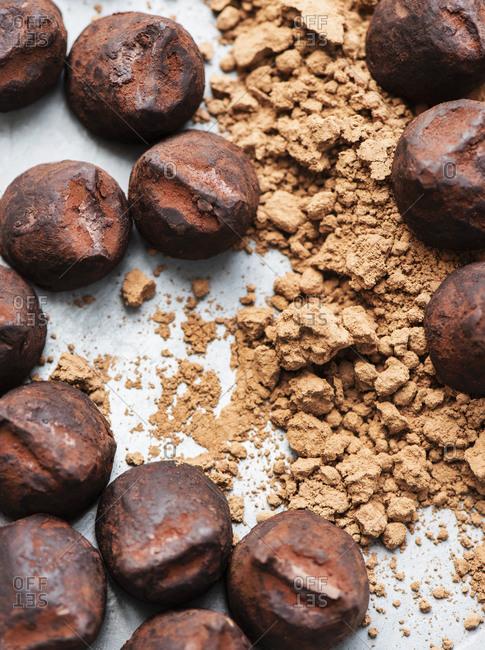 Chocolate truffles and cocoa powder