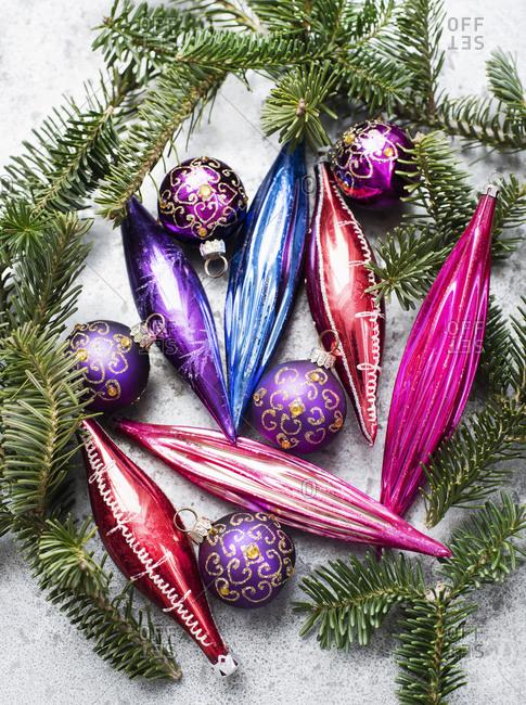 Colorful vintage glass bulbs with twig of Christmas tree