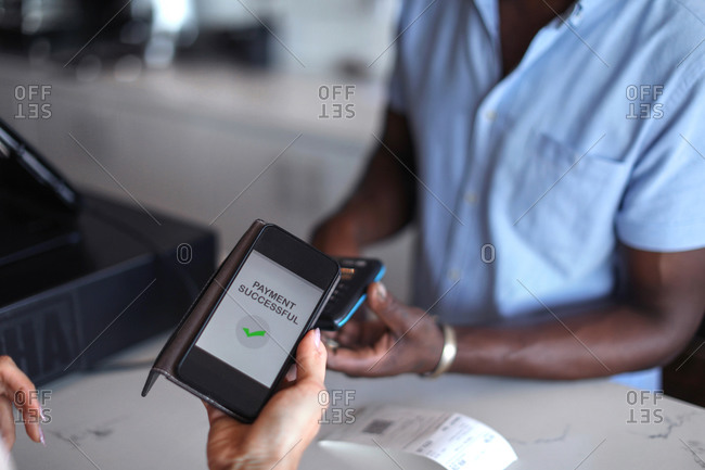 Customer paying with e-cash at counter