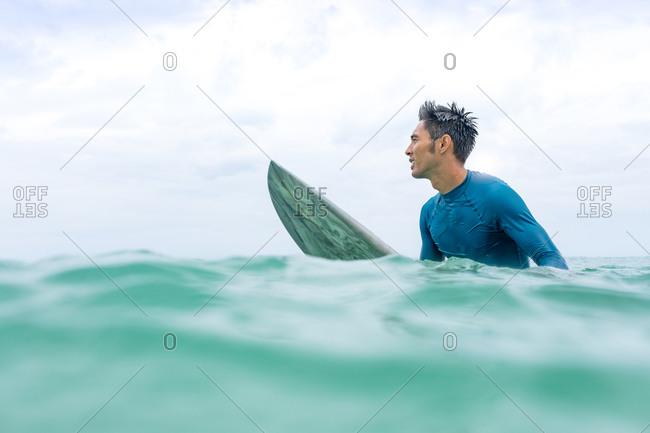 Surfer waiting in sea, Pagudpud, Ilocos Norte, Philippines