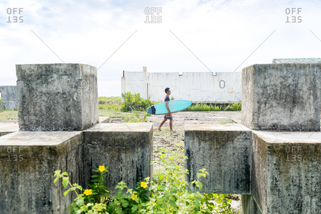 Man with surfboard, Abulug, Cagayan, Philippines