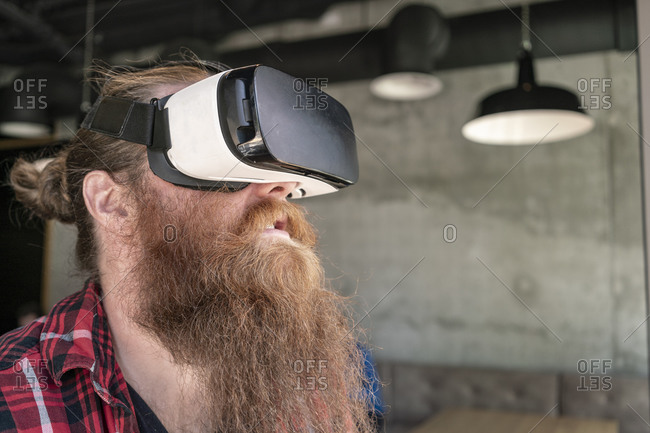 Male hipster using VR goggles