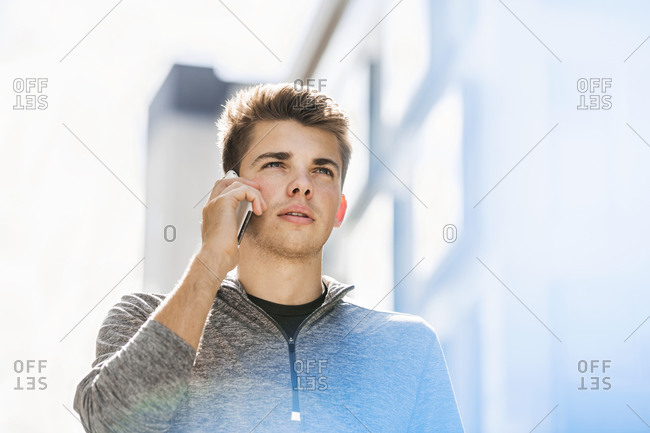 Young man using smartphone in city