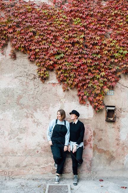 Women beside wall with ivy