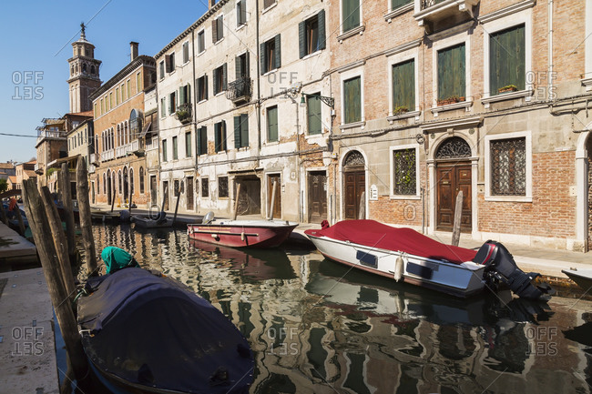 Moored boats on narrow canal, Renaissance architectural style residential palace buildings, Dorsoduro district, Venice, Veneto, Italy