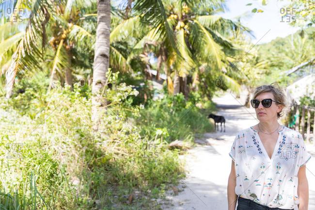 Woman exploring village, Ginto island, Linapacan, Philippines