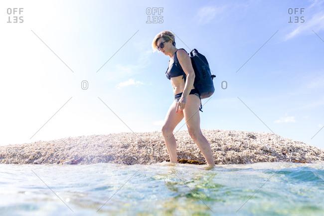 Woman exploring seaside, Ginto island, Linapacan, Philippines