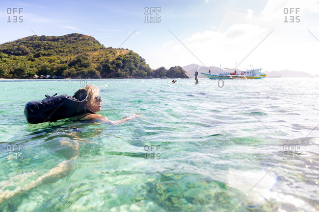 Woman swimming in sea, Ginto island, Linapacan, Philippines