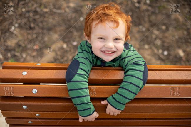 Portrait of boy on park bench