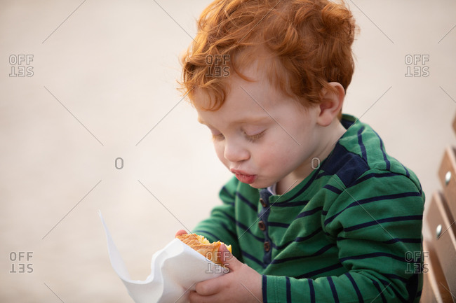 Boy enjoying piece of cake