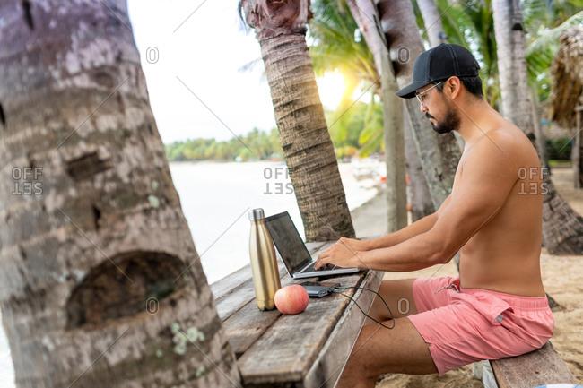 Man on video call on laptop, Pagudpud, Ilocos Norte, Philippines
