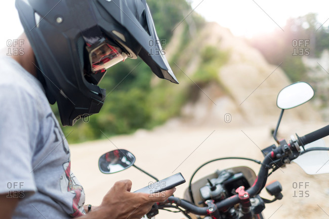 Motorcyclist stopping to text, Pagudpud, Ilocos Norte, Philippines