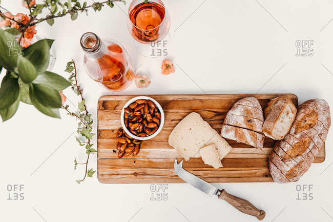 Snack board with wine styled on white