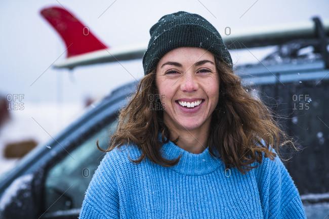 Woman surfer portrait with frozen surfboard