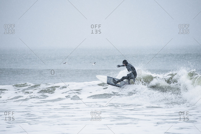 Man surfing during winter snow