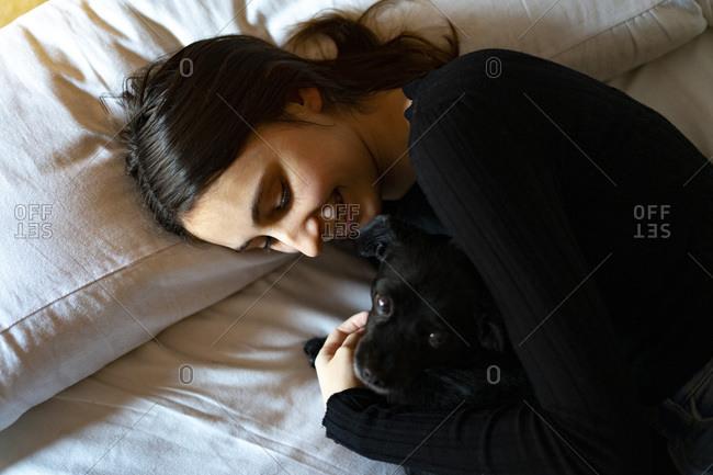 Woman sleeping with a dog.