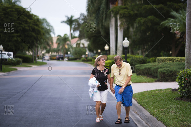 Senior Couple walking hand in hand enjoying retirement