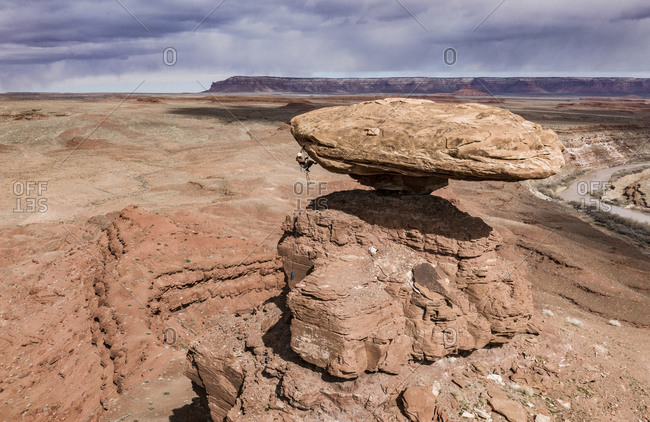 A climber takes in the view on Mexican Hat Rock