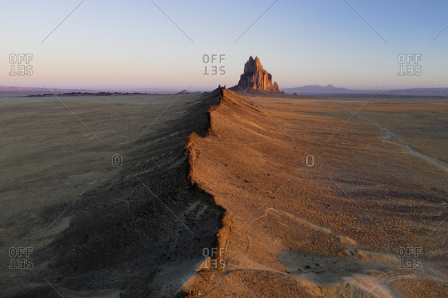 Aerial with leading line of lava towards Shiprock in New Mexico