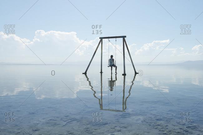 Self Portrait on Swing Set in Reflection on Salton Sea California