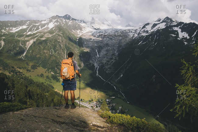 Man hiker standing on a hilltop in the French Alps, Le Tour, France