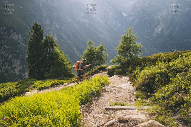 Man hiker going up to Aiguillette des Posettes, French Alps, Chamonix