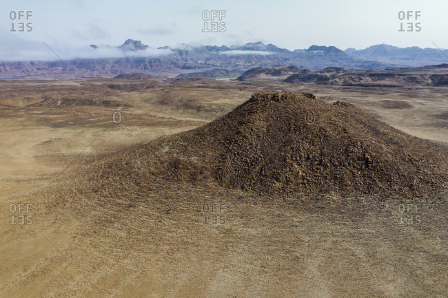 Aerial view of a volcanic hill in the Namibian desert