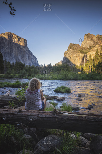 Woman observes Yosemite National Park environment, Capitan View