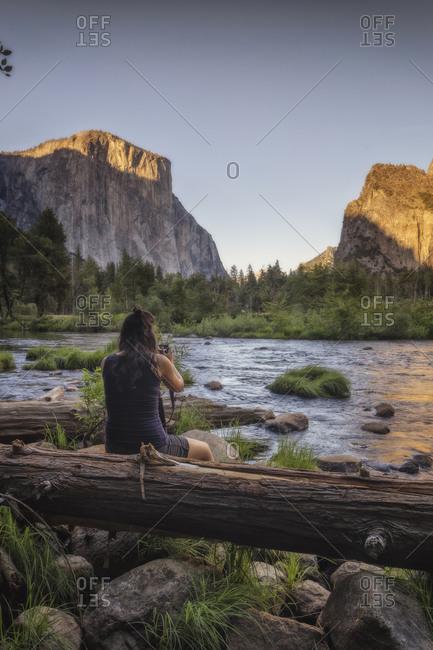 Woman photographing Yosemite National Park