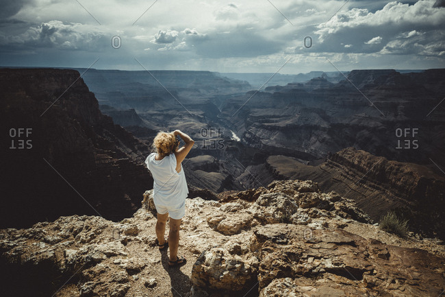 Woman photographing Grand Canyon environment at summer
