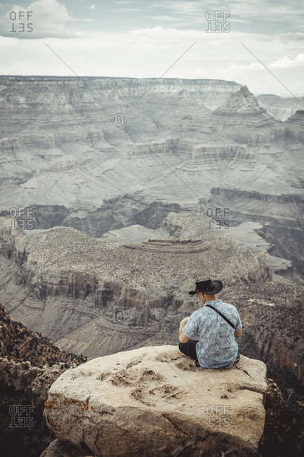 Man Observe Colorado River from Grand Canyon point