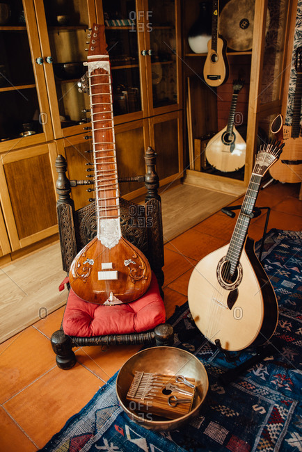 Instruments in a musical store: sitar, Portuguese guitar, kalimba