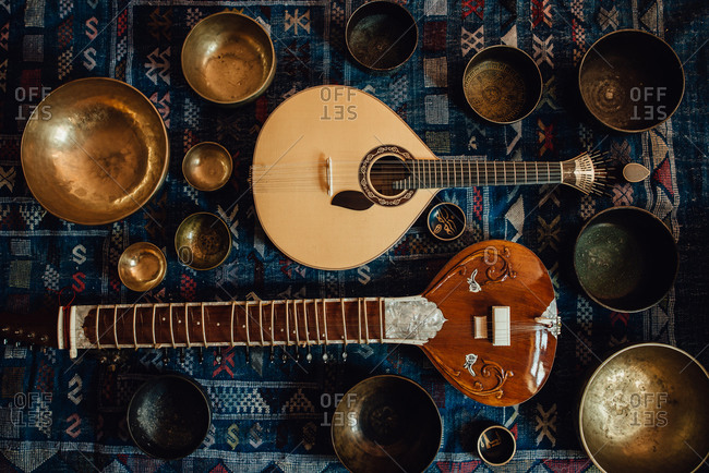 Traditional instruments: sitar and Portuguese guitar and singing bowls