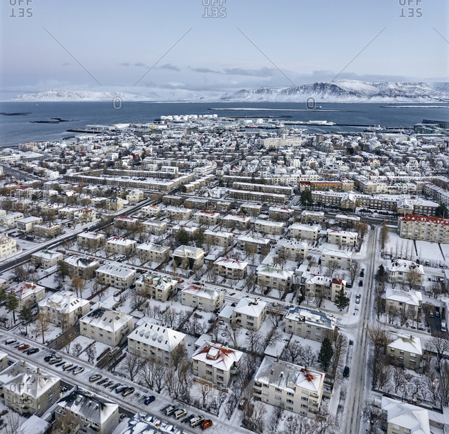 Rows of alike buildings in city district from drone