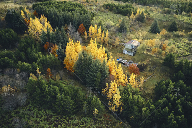 Remote country house in autumnal land from drone
