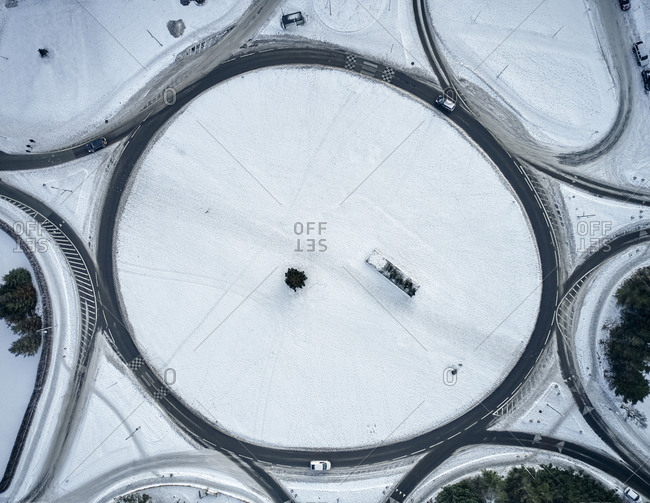 Round road junction in snowy countryside