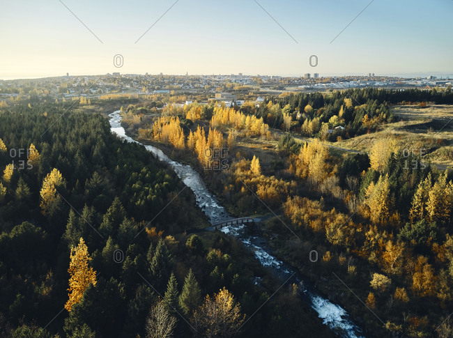 Fast river through autumn countryside
