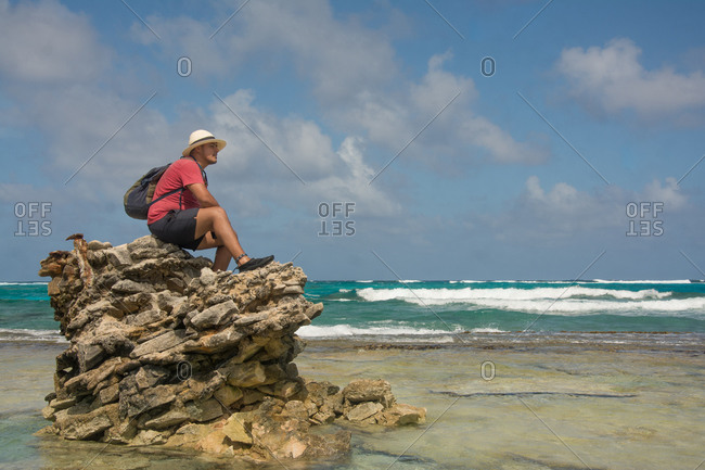 Man seated on a rock formation
