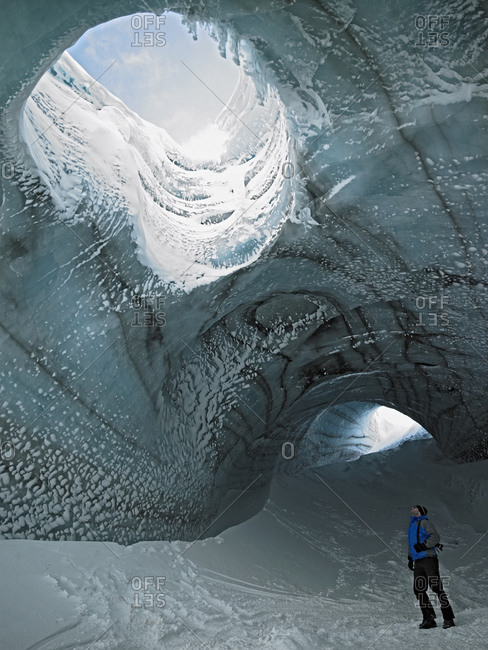 Man exploring ice cave in Iceland