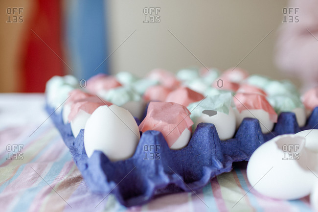 Closeup of decorated eggshells pink and aqua