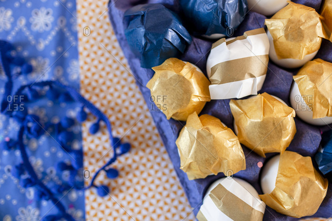 closeup of decorated eggs with gold and white paper
