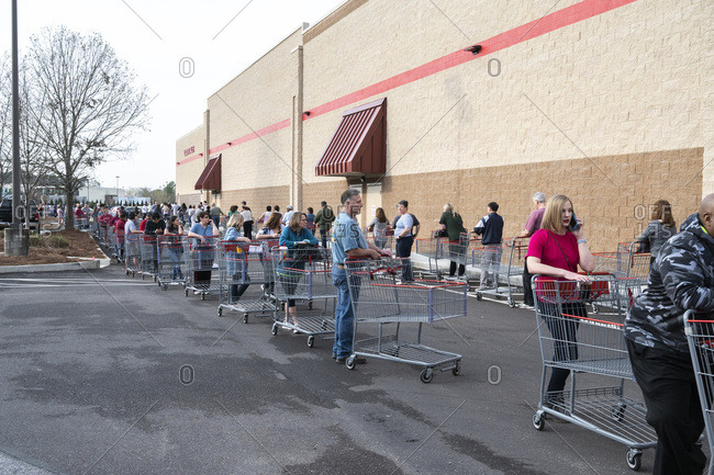 United States, Alabama, Hoover - March 14, 2020: Shoppers waiting in line to get into a Costco store at the opening. Alabama.