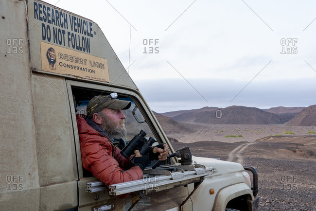 Hentiesbaai, Erongo Region, Namibia - September 19, 2019: Portrait of Philip Stander, researcher, in his research vehicle