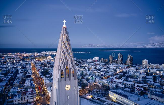 Reykjavik, Iceland - December 8, 2019: Picturesque drone view of illuminated church in Reykjavik