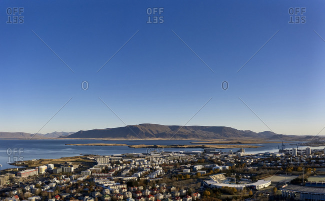 Reykjavik, Iceland - October 18, 2019: Contemporary coastal town under blue sky