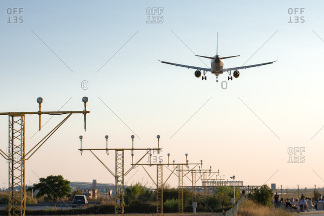 Barcelona, CT, Spain - August 2, 2019: airplane landing at sunset
