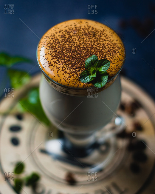 Close-up of Dalgona coffee with mint and coconut sugar