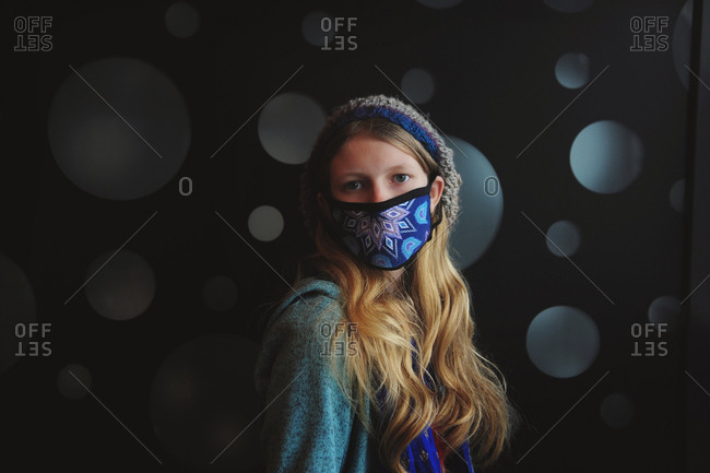 Young girl posing with personal protective face mask
