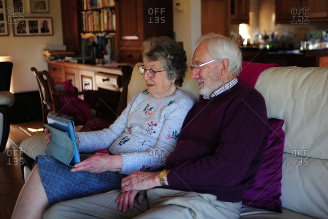 Grandparents using a digital table to communicate