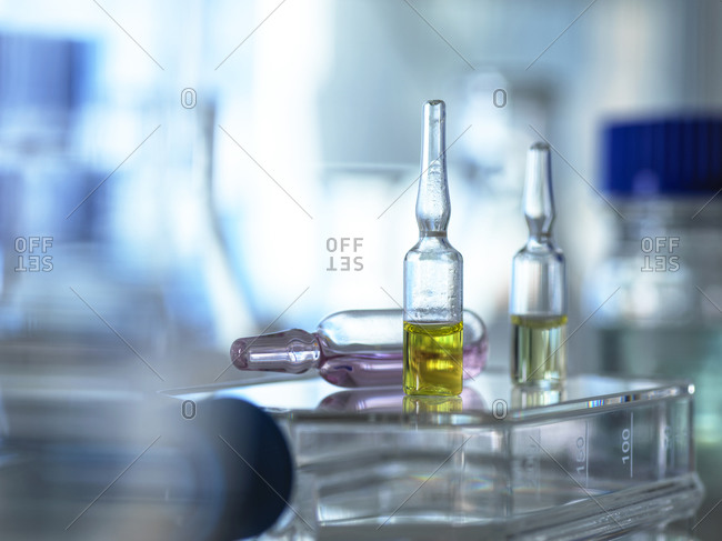 Close-up of various pharmaceutical vials standing in laboratory